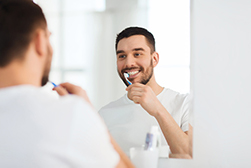 Am I Hurting My Gums by Brushing Too Much?